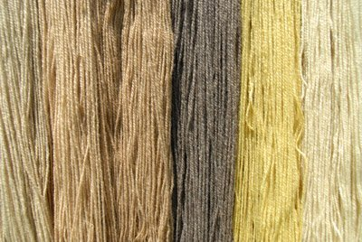 4 Mullein dyed skeins on left, 2 Dandelion on right