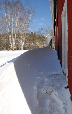 Impassable snow drift on west side of barn