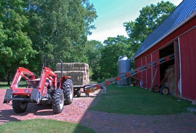 unloading hay in June