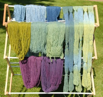 Over-dyed red and yellow skeins, plus multicolored warp yarns (to the right)