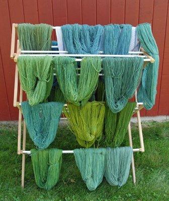 yellow yarn overdyed with indigo into greens