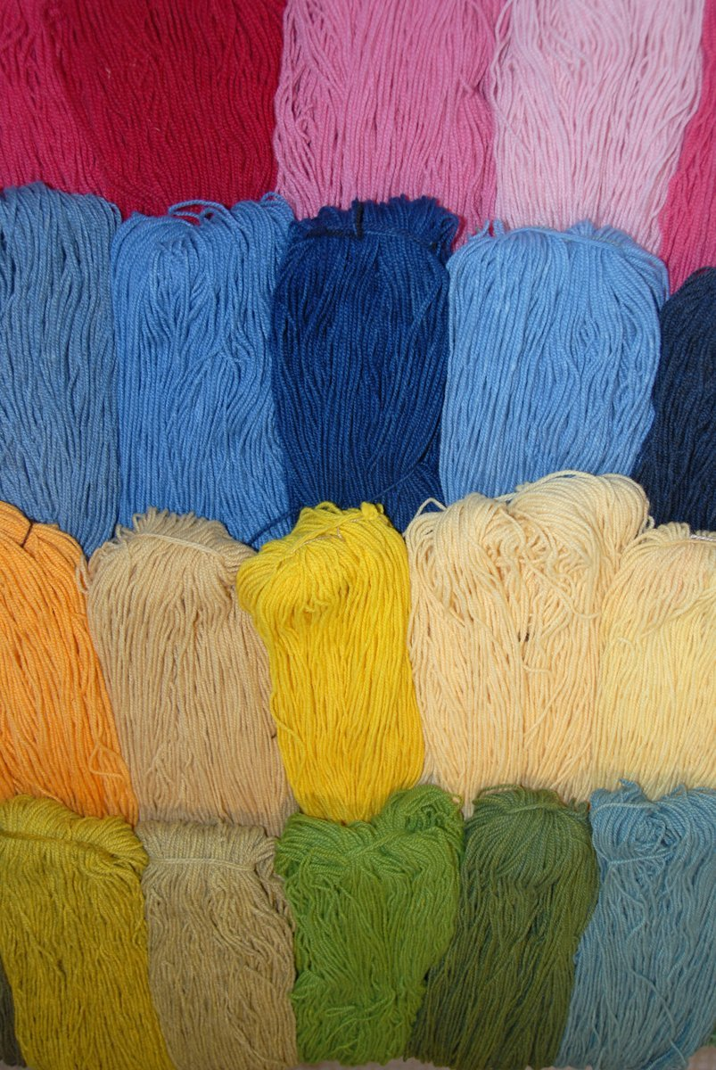 Display of naturally dyed yarn for sale in Whitefish Bay Farm Gallery