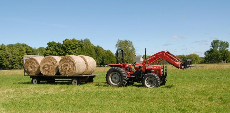 Loading Round bales for storage