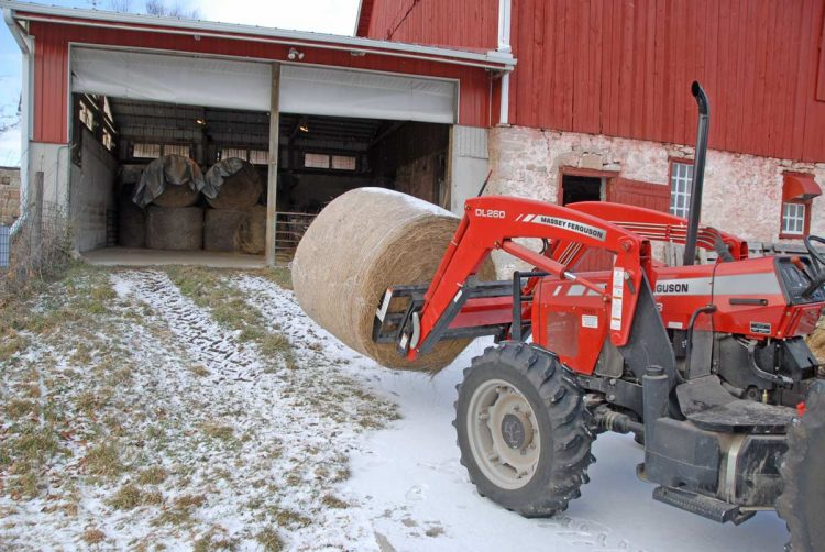 Round bale moving into barn annex