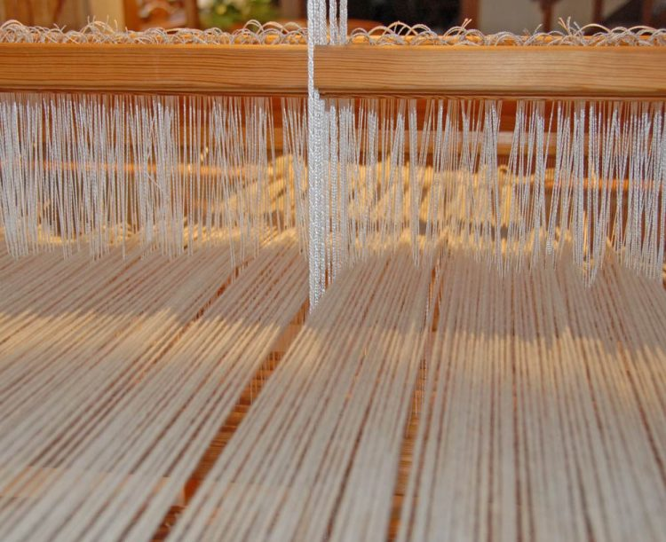 warp from behind the loom