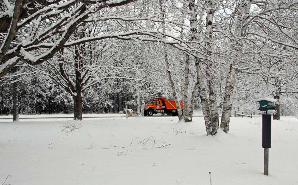 Door County plow clearing snow on January 1st