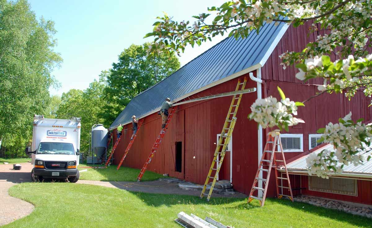 Installing new barn gutters