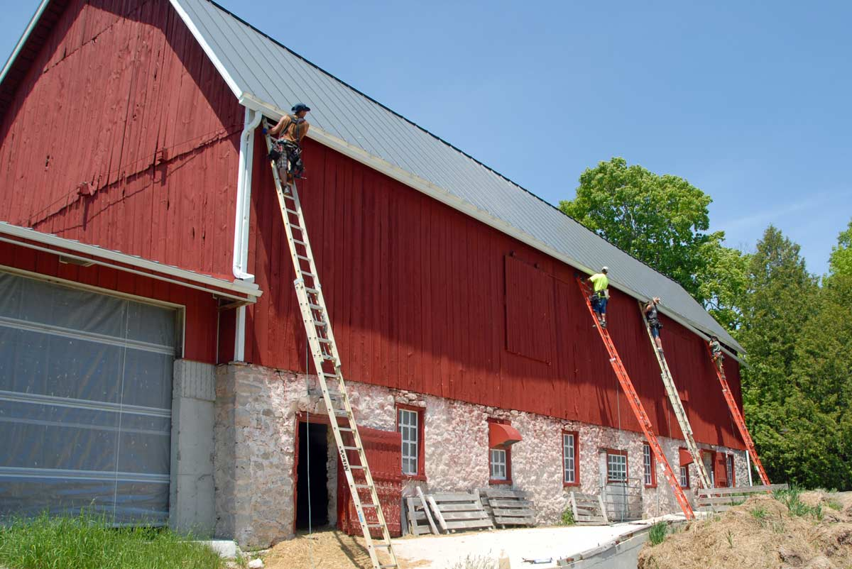 Installing new guuters on the east side of the barn