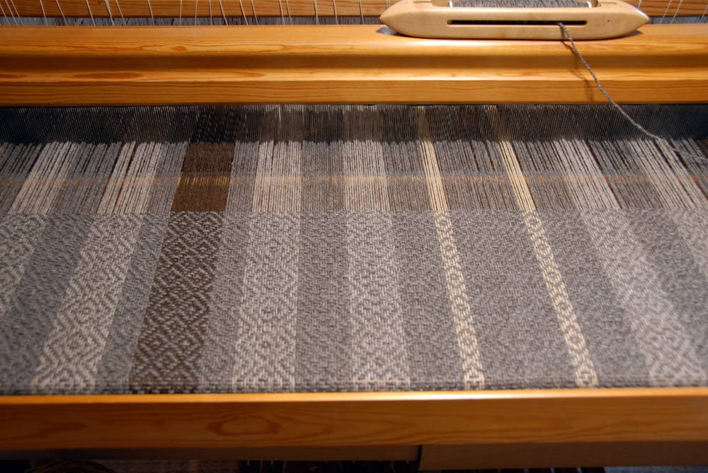 Close up of a blanket on the loom