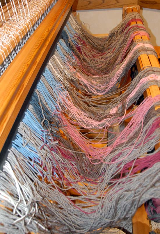A mess of yarn just tied onto the loom