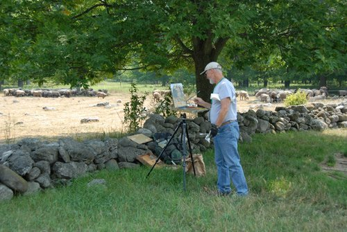 Artist painting an image of the flock on pasture